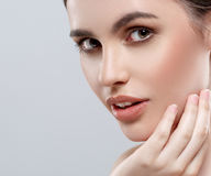 Beautiful woman face studio on white with sexy lips gray background Royalty Free Stock Image