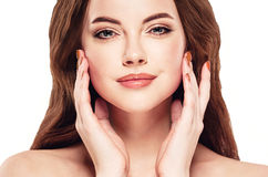 Beautiful woman face studio on white with sexy lips touching her face Stock Photography