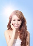 Beautiful woman face with sunshine and sky. Beautiful woman face with sunshine and blue sky, concept for skin care and sun block, asian beauty Stock Images