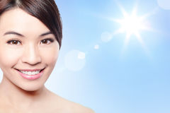 Beautiful woman face with sunshine and sky Royalty Free Stock Images