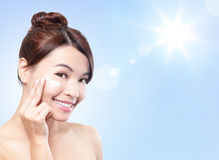 Beautiful woman face with sunshine and sky. Beautiful woman face with sunshine and blue sky, concept for summer skin care and sun block, asian beauty royalty free stock images