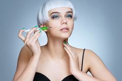 Beautiful woman face with syringe making rejuvenate injection. Clean Beauty concept Royalty Free Stock Photos