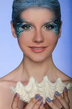 Beautiful woman in the face-up mermaid Royalty Free Stock Images