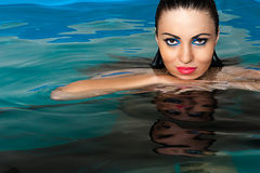 Beautiful woman face in the water Stock Photo