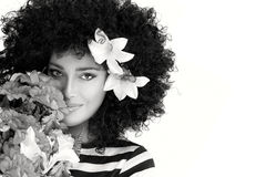 Beautiful Woman Face with Wild Curly Afro Hairstyle with Flowers Stock Photo