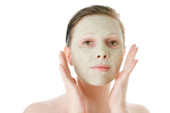 Beautiful woman with facial mask Stock Images