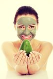 Beautiful woman with facial mask holding avocado Stock Photography