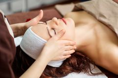 Beautiful woman at a facial massage at a spa salon. Beautiful women at a facial massage at a spa salon royalty free stock image