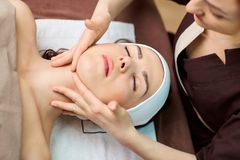 Beautiful woman at a facial massage at a spa salon. Beautiful women at a facial massage at a spa salon stock photos