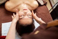 Beautiful woman at a facial massage at a spa salon. Beautiful women at a facial massage at a spa salon stock photography