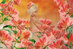 Beautiful woman in fairy garden Stock Photography