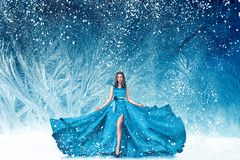 Beautiful woman in fairy tale forest. Beautiful young woman in fairy tale forest with long luxurious dress Royalty Free Stock Photo
