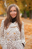 Beautiful woman at fall. Beautiful young woman at fall royalty free stock photo