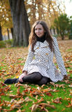 Beautiful woman at fall. Beautiful young woman at fall royalty free stock photos