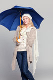 Beautiful woman in fall fashion holding an umbrella Royalty Free Stock Images