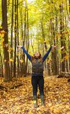 Beautiful Woman Fall Leaves Forest. Beautiful woman in the outdoors delights in the fall leaves and colors in a forest Stock Photography