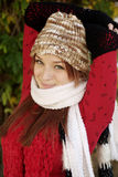 Beautiful Woman in Fall Season. A beautiful woman with a red hair, red scarf, and red top Royalty Free Stock Photos