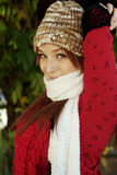 Beautiful Woman in Fall Season. A beautiful woman with a red hair, red scarf, and red top Stock Photo