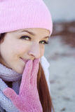 Beautiful Woman in Fall Season. A beautiful woman with a red hair, white scarf, and pink bonnet and gloves Stock Images