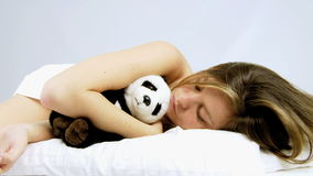 Beautiful woman falling asleep with panda plush Royalty Free Stock Images