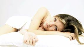 Beautiful woman falling asleep slowly wide shot stock footage
