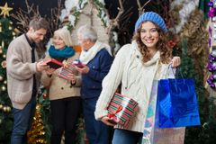 Beautiful Woman With Family In Christmas Store Stock Photos