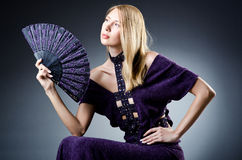 Beautiful woman with  fan Royalty Free Stock Photography