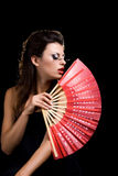 Beautiful woman  with fan Stock Image