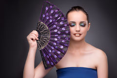 The beautiful woman with fan in fashion concept Stock Photos