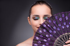 The beautiful woman with fan in fashion concept Stock Photography