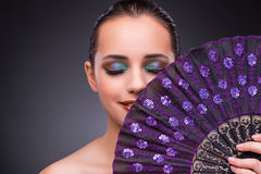 The beautiful woman with fan in fashion concept Royalty Free Stock Photos