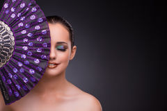 The beautiful woman with fan in fashion concept Stock Images