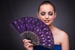 The beautiful woman with fan in fashion concept Royalty Free Stock Images
