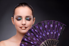 The beautiful woman with fan in fashion concept Royalty Free Stock Photography