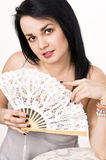 A beautiful woman with a fan Stock Photos