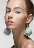 Beautiful woman with fancy earrings Royalty Free Stock Photo