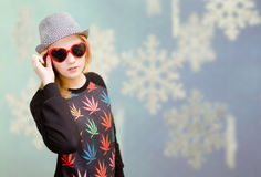 Beautiful woman in fancy sunglasses smiling on Stock Images