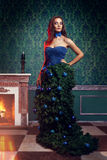 Beautiful woman in fantasy christmas tree dress in rich vintage Stock Photo