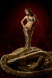Beautiful woman in fantasy dress. Snake stylish Royalty Free Stock Images