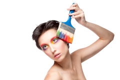Beautiful woman with fantasy makeup holding brush Royalty Free Stock Photos