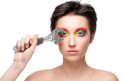 Beautiful woman with fantasy makeup holding wrench Royalty Free Stock Photos