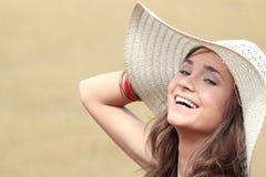 Beautiful woman on farmland. A portrait of a beautiful woman on farmland royalty free stock photo