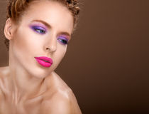 Beautiful woman with fashion bright makeup of eyes and pink Stock Photo