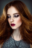 Beautiful woman with fashion hairstyle. Close up portrait of beautiful woman with fashion hairstyle and bright make up Stock Photography