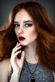 Beautiful woman with fashion hairstyle. Close up portrait of beautiful woman with fashion hairstyle and bright make up Royalty Free Stock Image