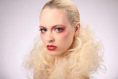 Beautiful woman with fashion hairstyle and glamour makeup Royalty Free Stock Images