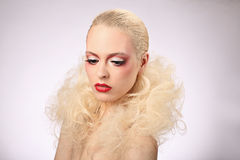 Beautiful woman with fashion hairstyle and glamour makeup Royalty Free Stock Photography