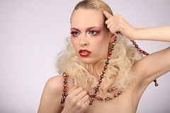 Beautiful woman with fashion hairstyle and glamour makeup Stock Image