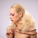 Beautiful woman with fashion hairstyle and glamour. Makeup, studio Royalty Free Stock Photos