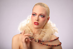 Beautiful woman with fashion hairstyle and glamour Stock Photos